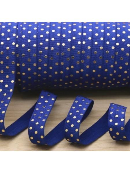 Резинка эластичная,1,5см-золотые горошки на синем. цена за 1 метр