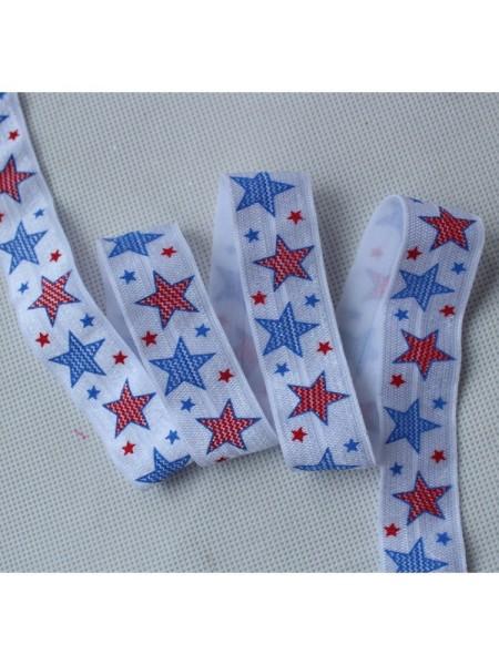 Резинка эластичная,1,5см-звёзды синие и красные. цена за 1 метр