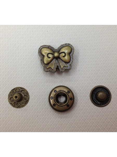 Кнопка Бантик.цв.бронза,18*15 мм,цена за 1 шт